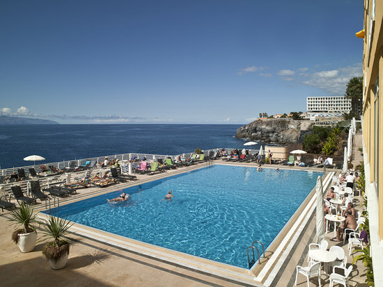 🏨 atlantic holiday center - apartments hotel - tenerife travel guide include multilingual staff as well