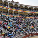 Buying tickets to some bullfight in the country